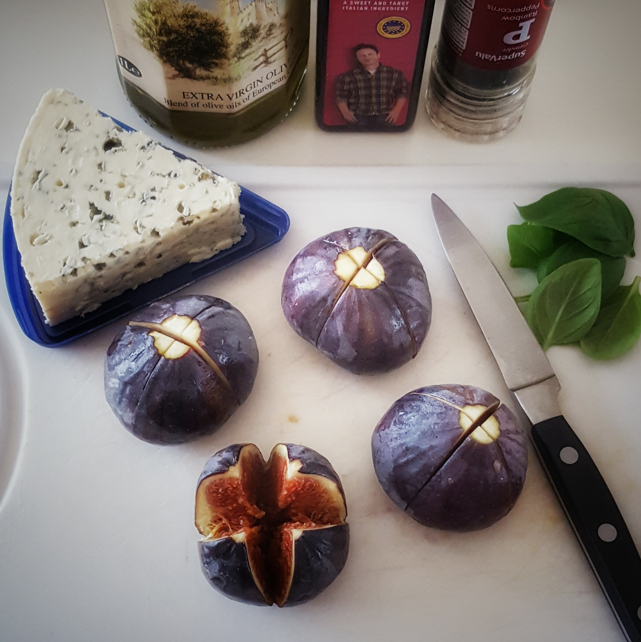 figs, blue cheese, and knife